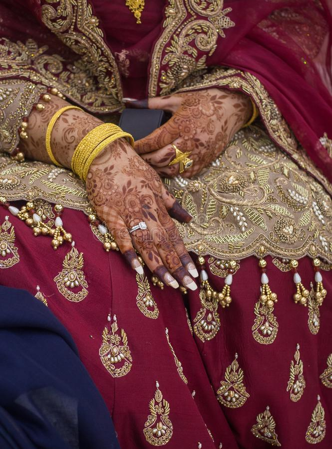 Asian bridal Mehndi with ring. Mehndi is a form of body art originating in ancient India, in which decorative designs are created on a person`s body, using a stock photo