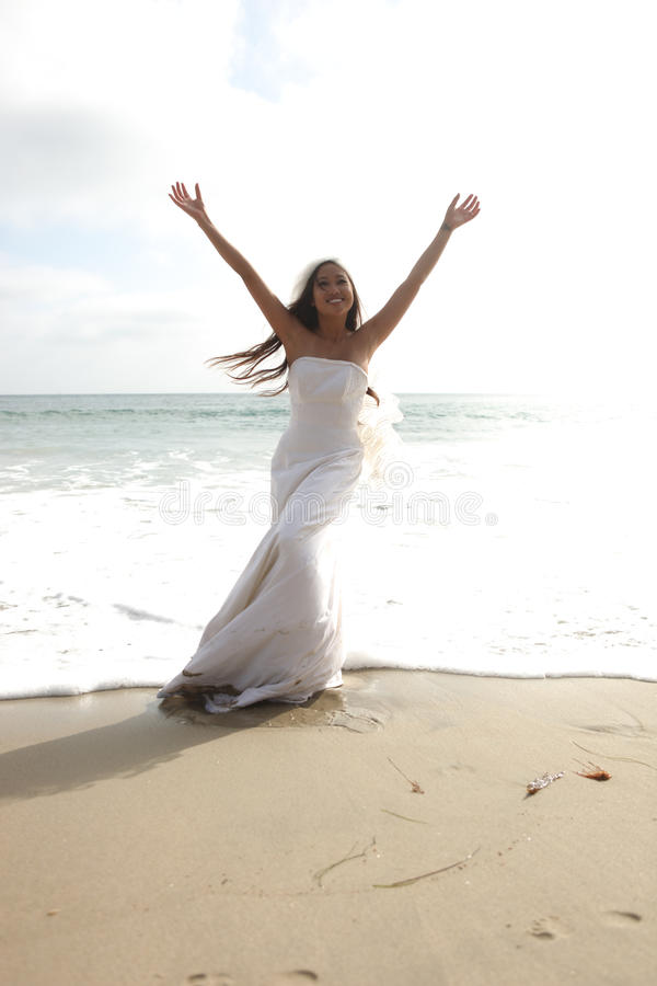 Download Asian Bride Celebrating Her Joy On The Beach Stock Photo - Image: 15644980