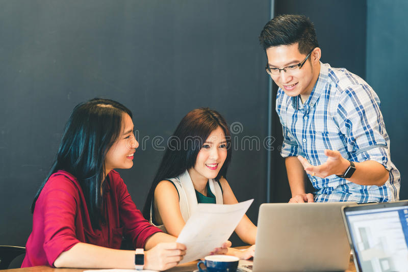 Asian business colleagues or college students in team casual discussion, startup project business meeting or teamwork brainstorm. Group of young Asian business stock images