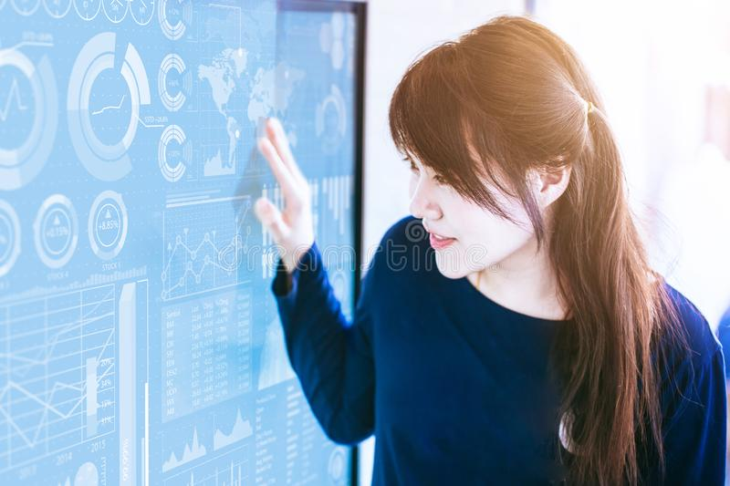 Asian Business economic watch. Asian women looking at display royalty free stock images