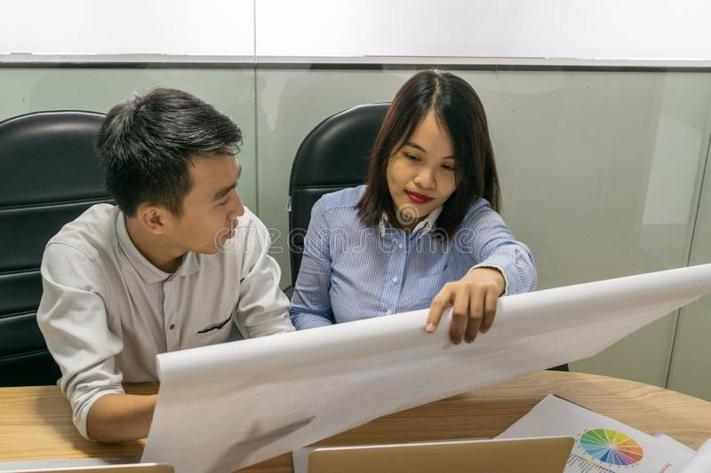 Asian business employees discuss about work on paper royalty free stock photos