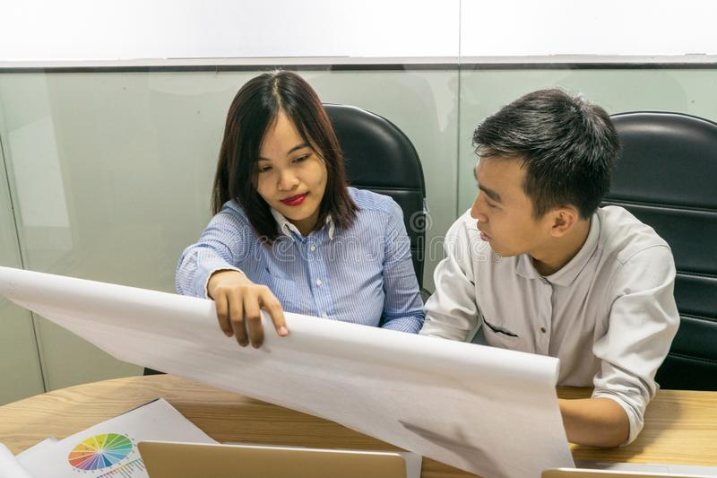 Asian business employees working in the office stock images