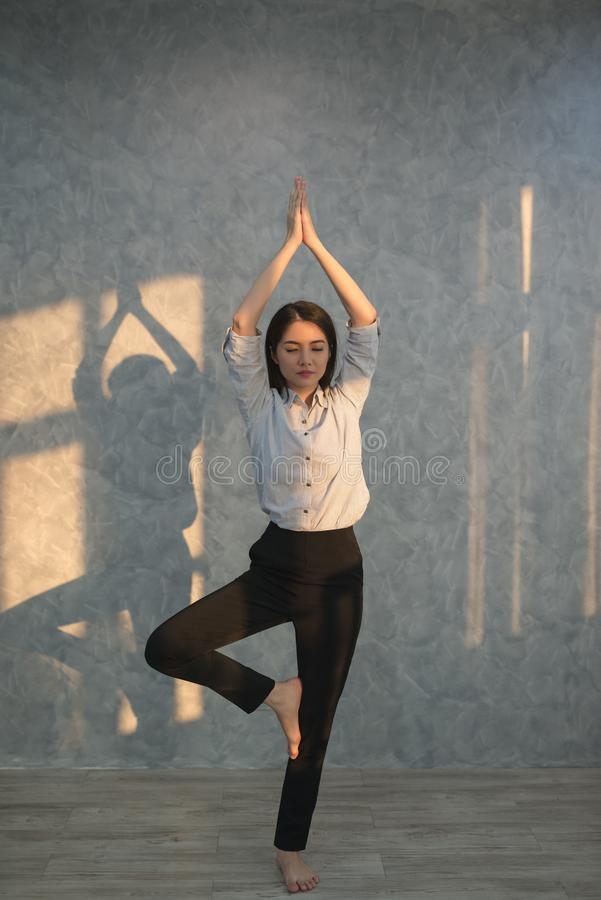 Asian business girl practicing yoga in the office. concept rela royalty free stock images