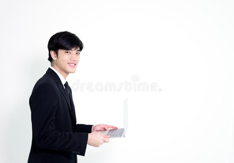 Asian business handsome man has holding laptop for woking with h stock photo