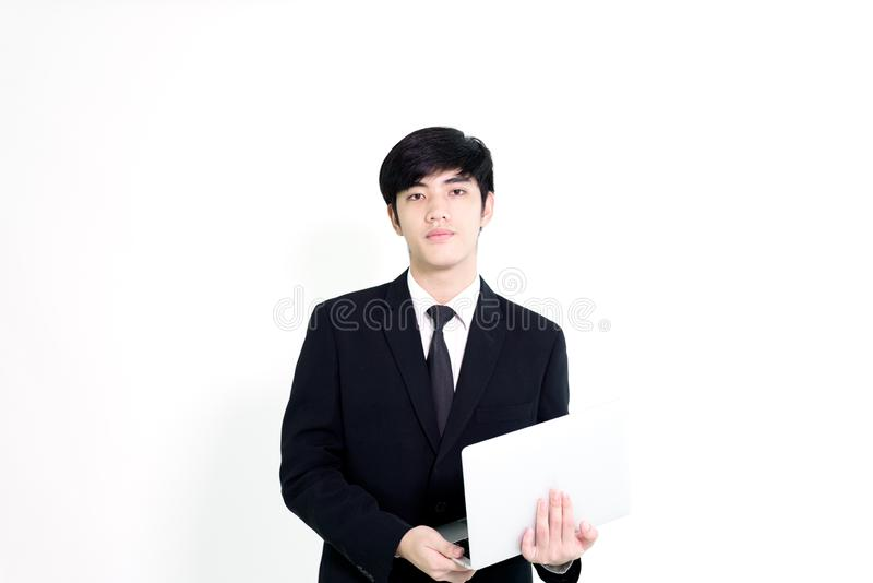 Asian business handsome man has holding laptop for woking isolated on white background. royalty free stock photography