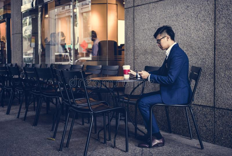 Asian business man in a cafe royalty free stock photo