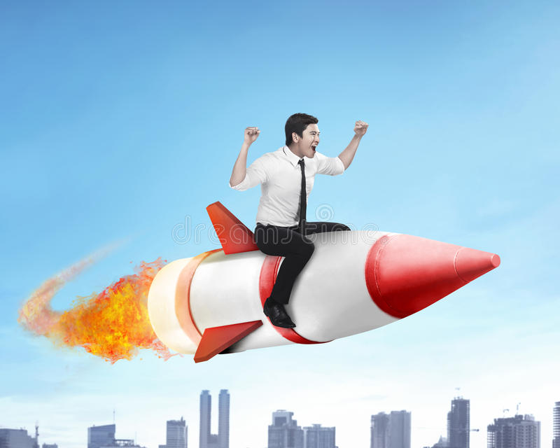 Asian business man flying ride rocket stock image