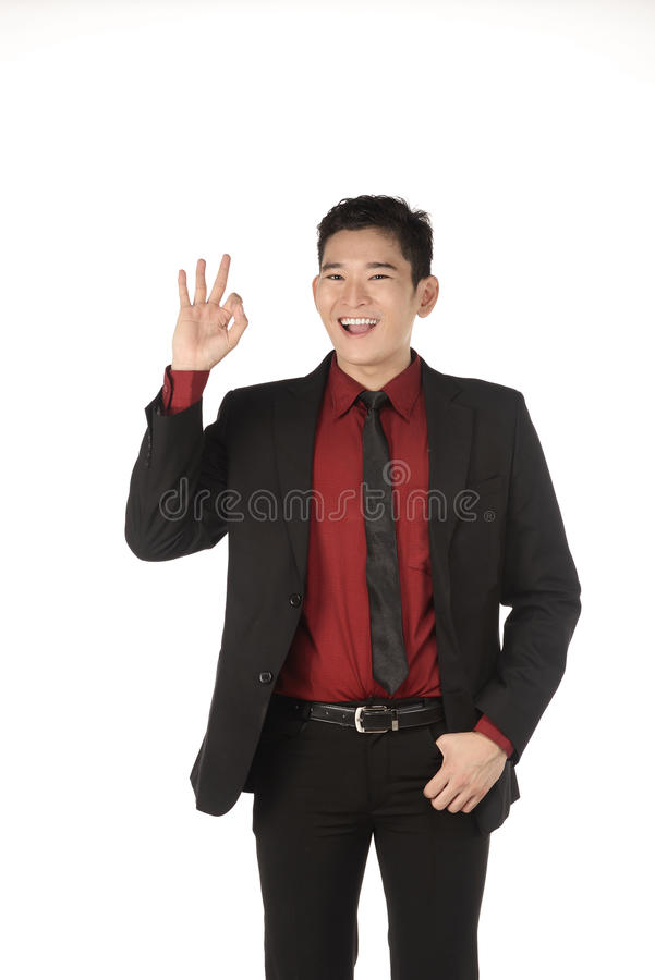 Asian business man give hand gesture OK royalty free stock photography