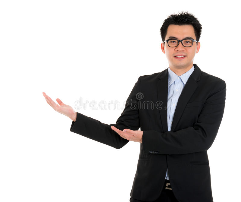 Asian business man hand showing blank space stock images