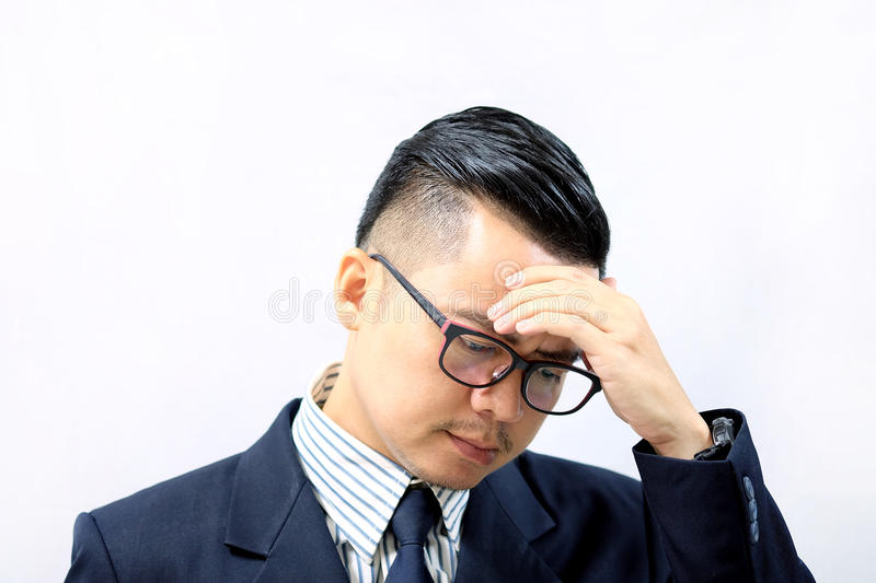 Asian business man with a headache stock photo