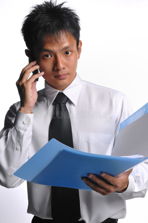 Asian business man holding file with phone stock photo