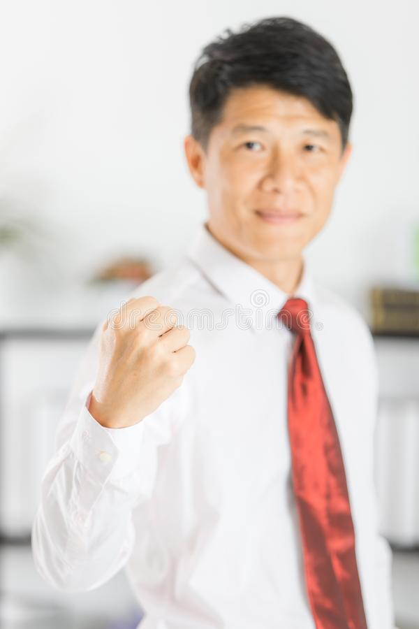 Asian business man isolated white. Close up portrait of middle aged, handsome, Asian, businessman, in white shirt, necktie, black pants posing confidently stock photos