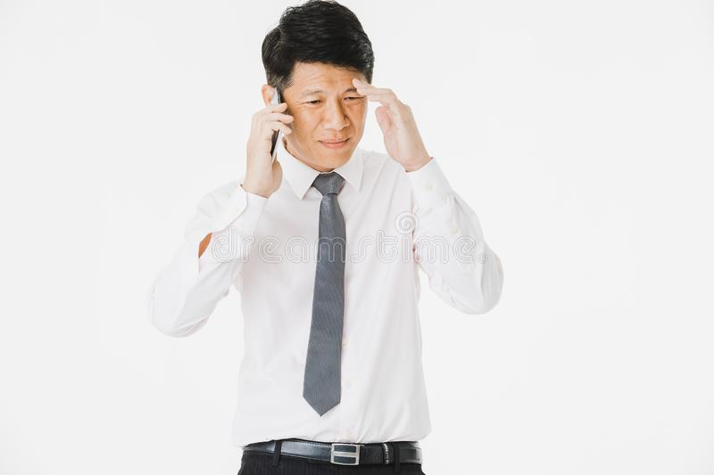 Asian business man isolated white. Close up portrait of middle aged, handsome, Asian, businessman, in white shirt, striped tie.posing, talking on smartphone with royalty free stock photography