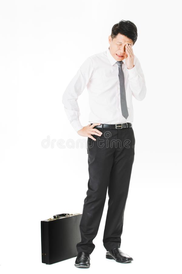 Asian business man isolated white. Full length portrait of middle aged, handsome, Asian, businessman, in white shirt, striped tie.black pants and shoes, holding royalty free stock photos