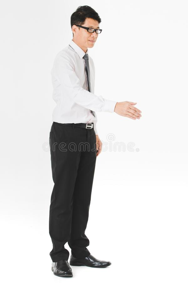 Asian business man isolated white. Half-length portrait of middle aged, handsome, Asian, businessman, in white shirt, striped tie, black pants, wearing stock image