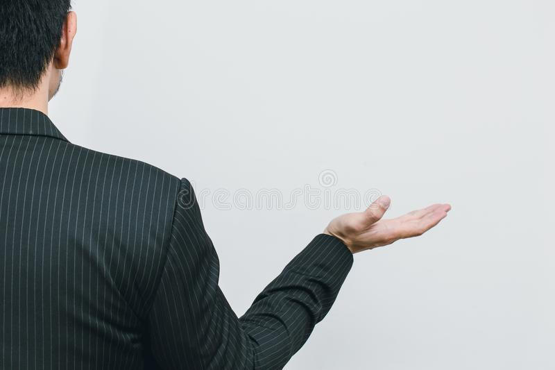 Asian business man open palm like present something stock photo