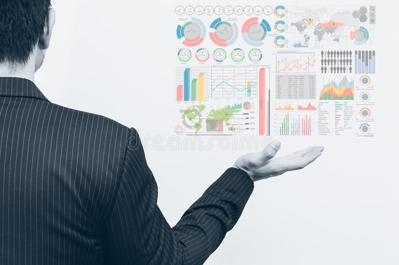 Asian business man open palm with marketing chart infographics royalty free stock photography