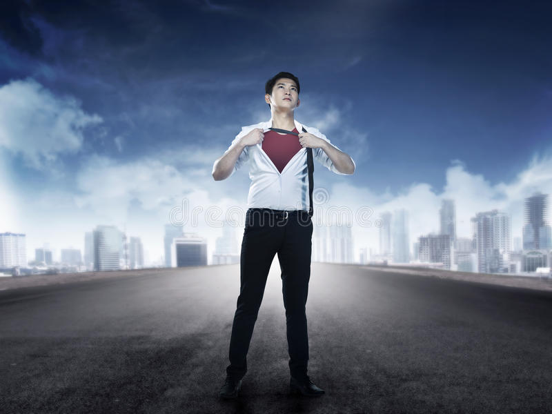 Asian business man open shirt like super hero. You can put your design on the shirt royalty free stock photography