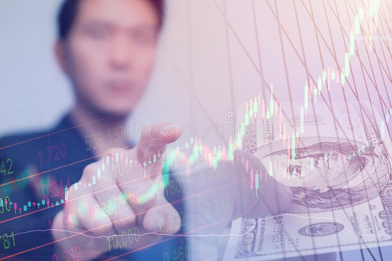 Asian business man pointing his finger to touch stock trader stock photo