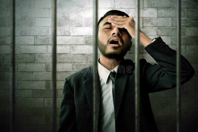 Asian business man in prison stock photo