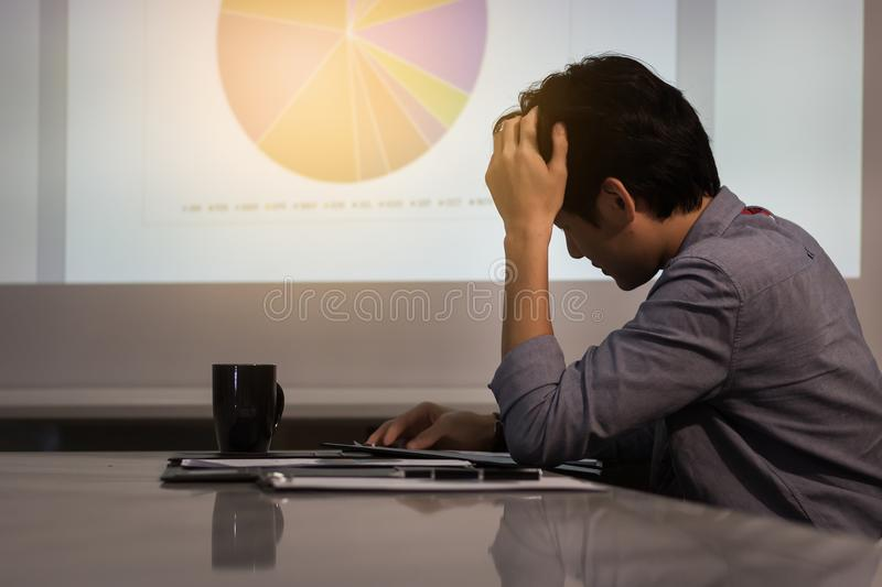 Asian business man is stressed royalty free stock photography