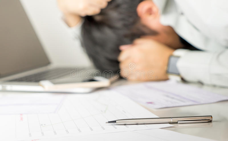 Asian Business man is stressed out royalty free stock photography