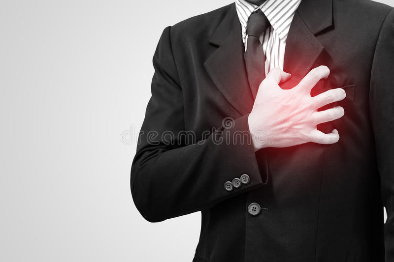 Asian business man with symptoms of heart stock image