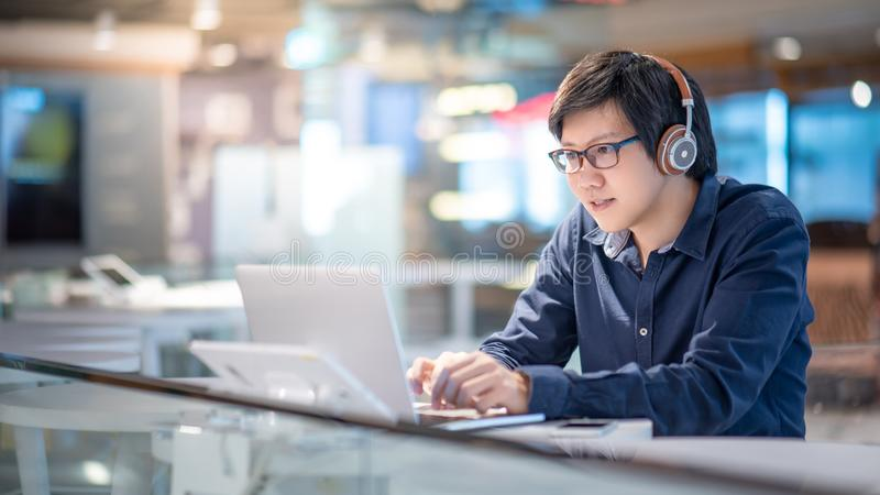 Asian business man using laptop computer royalty free stock images