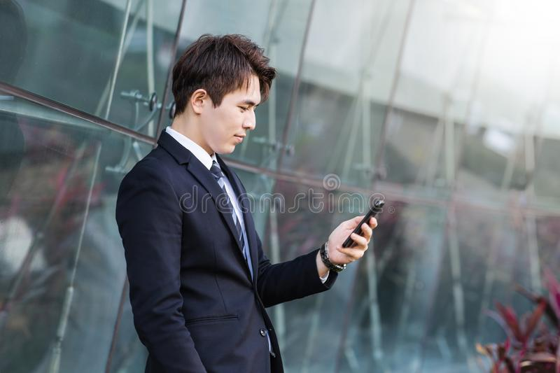 Business man using the smart phone with city building background royalty free stock photos