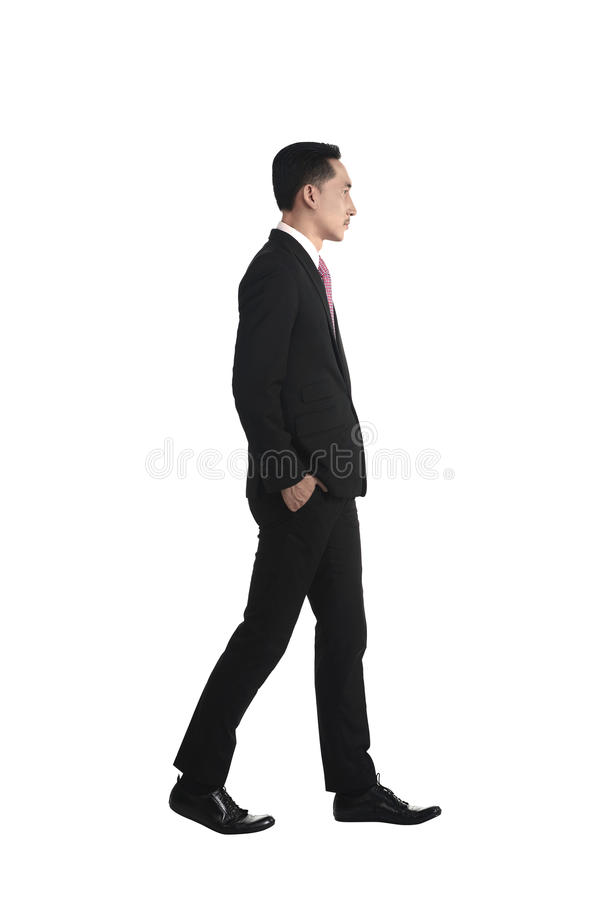 Asian business man walking royalty free stock photo