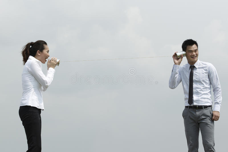 Download Asian Business Man And Woman Using Tin Can Phone. Stock Image - Image: 21589959
