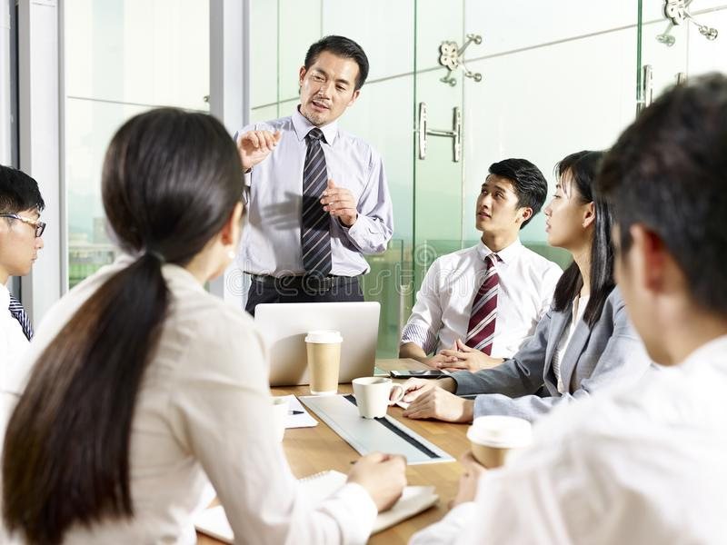 Asian business people meeting in office royalty free stock photography