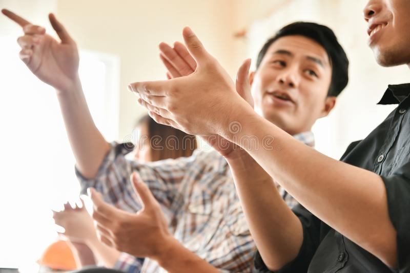 Asian business people clapping hands. royalty free stock photos