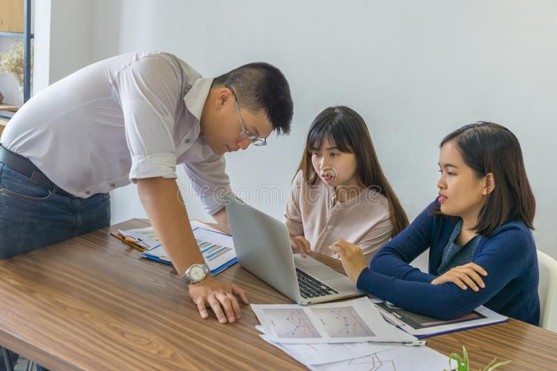 Asian business people discuss about financial report in the office stock images