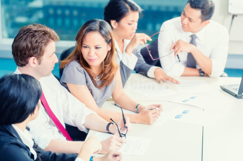 Asian business people having meeting in office royalty free stock photo
