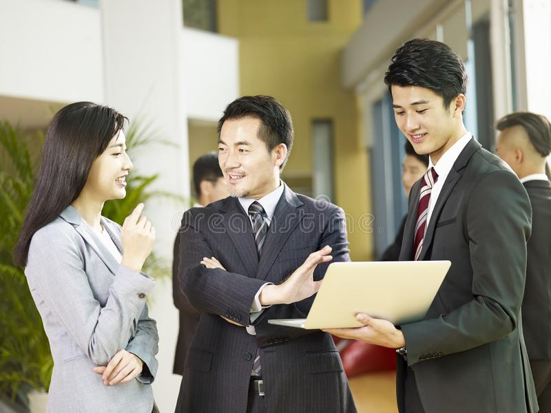 Asian business people meeting in company lobby royalty free stock photo