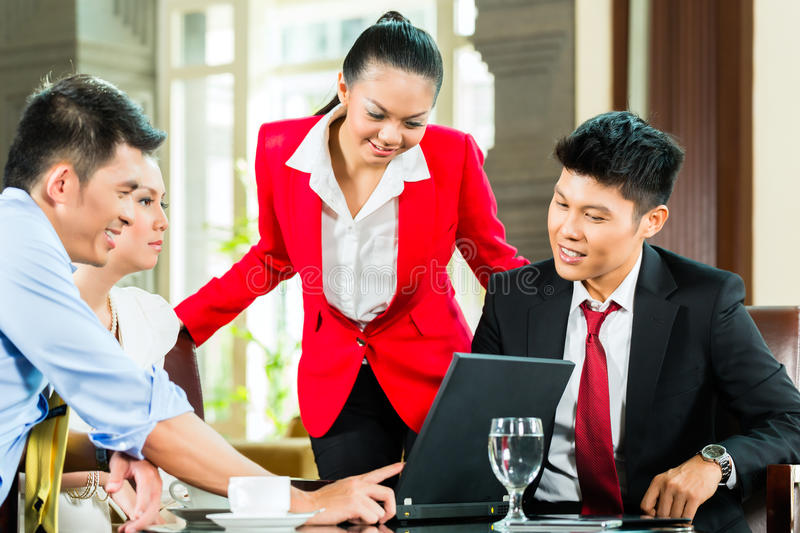 Download Asian Business People Meeting In Hotel Lobby Royalty Free Stock Photography - Image: 34447367