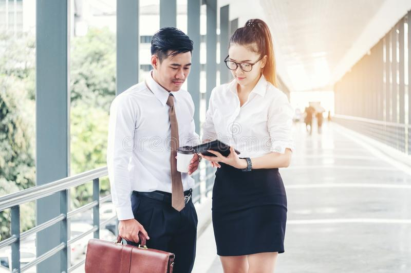 Asian business people meeting and using digital tablet outdoor after work royalty free stock images