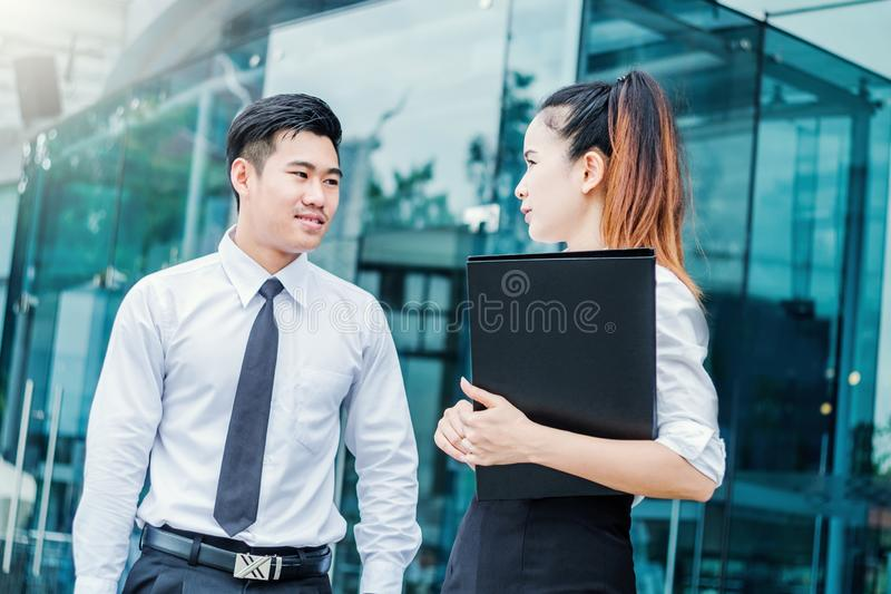 Asian business people meeting and using digital tablet outdoor after work stock photography
