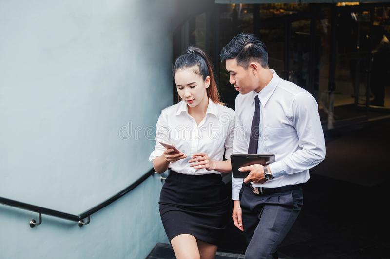 Asian business people meeting and using digital tablet outdoor after work royalty free stock photography