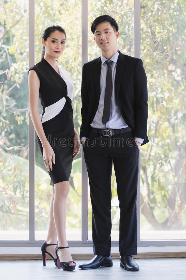 Asian business people posing in office royalty free stock photography