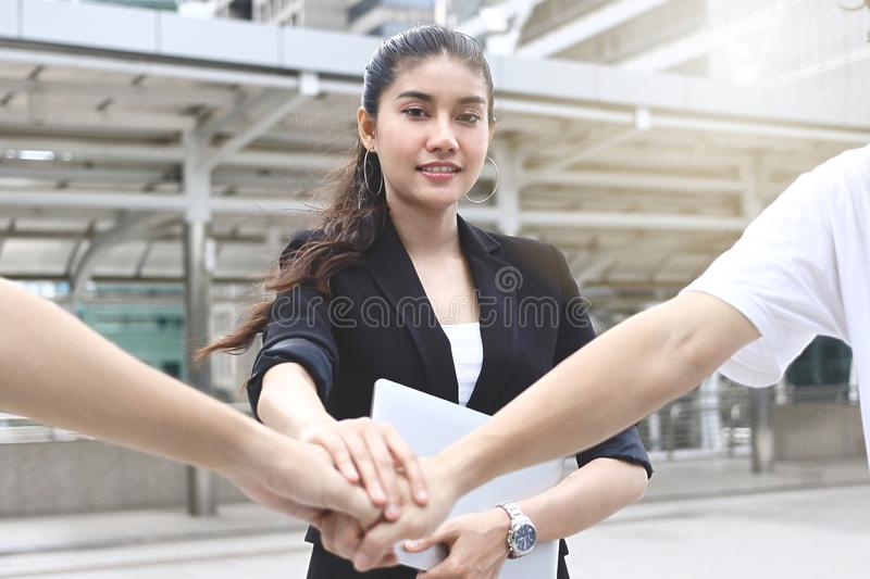 Asian business people stacking hands together. Successful and teamwork concept. Asian business people stacking hands together. Successful and teamwork concept stock photography