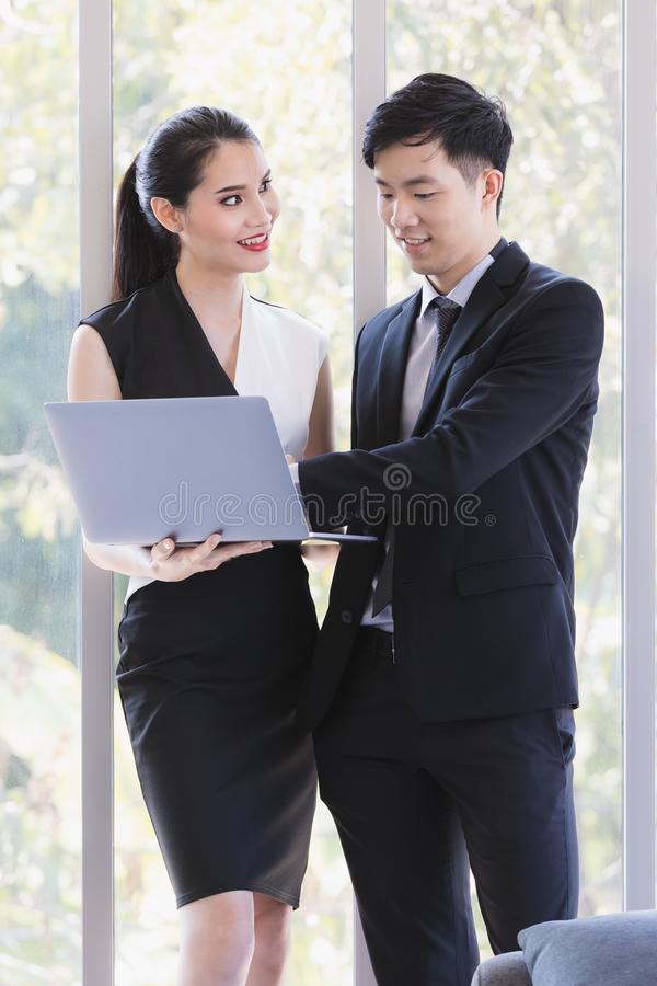 Asian business people standing in office stock photography