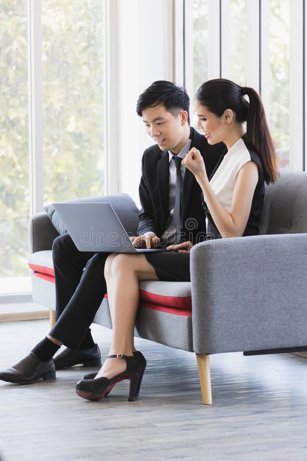 Asian business people using laptop in office royalty free stock photo