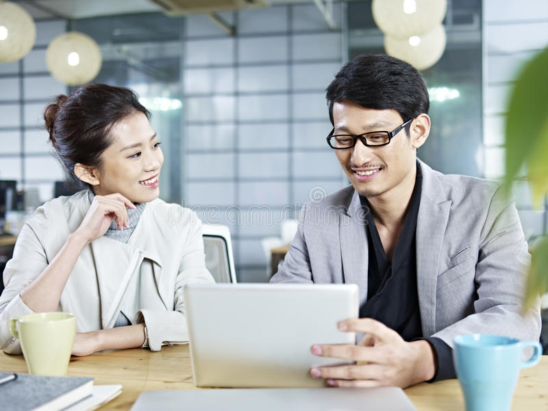 Asian business people working together in office royalty free stock photo