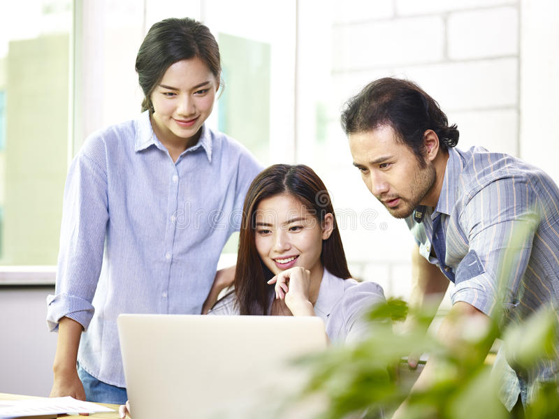 Asian business people working together in office royalty free stock image