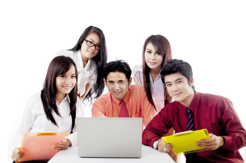 Asian business team with laptop isolated over white stock photos