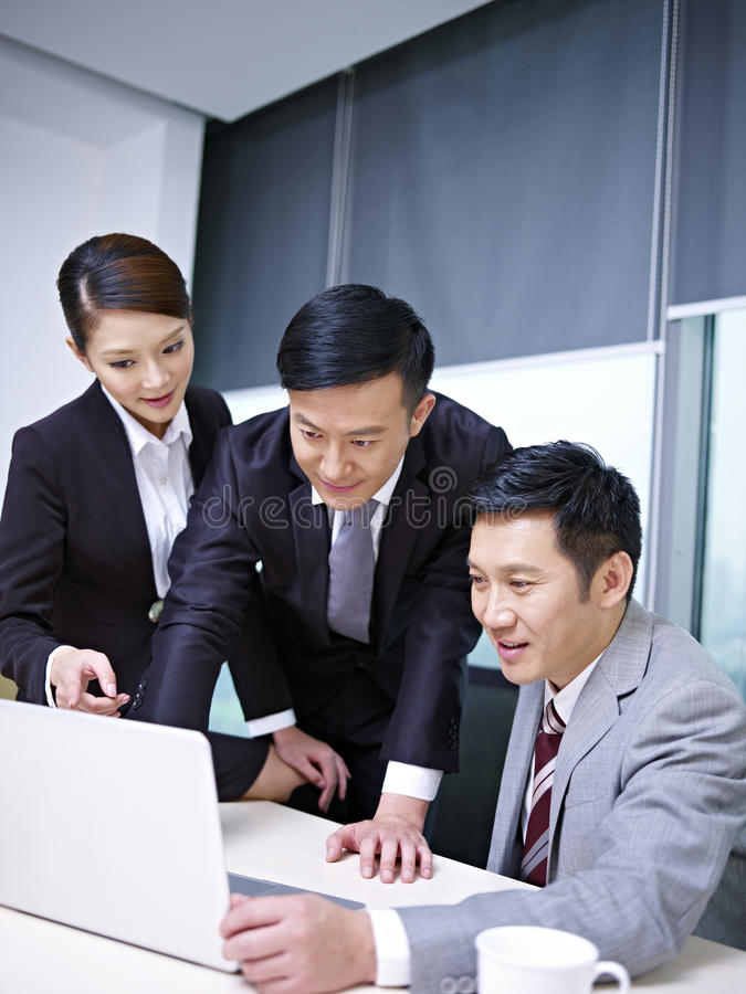 Download Asian business team stock photo. Image of female, analyzing - 30933504