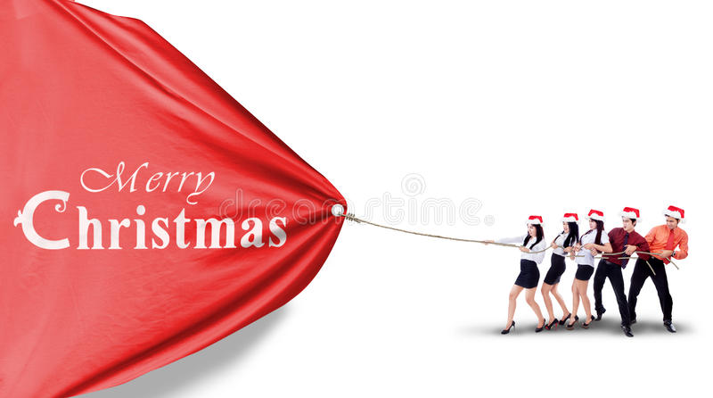 Asian Business team pull christmas banner royalty free stock images