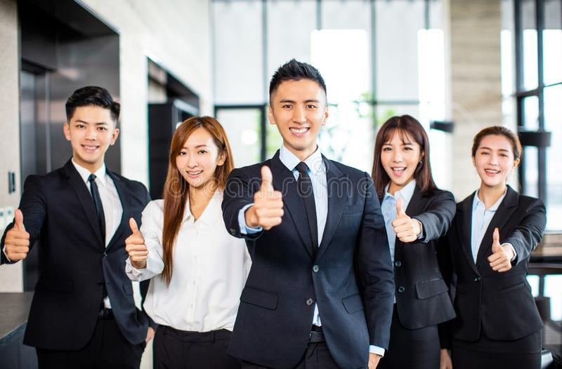 business team standing and showing thumbs up stock photography